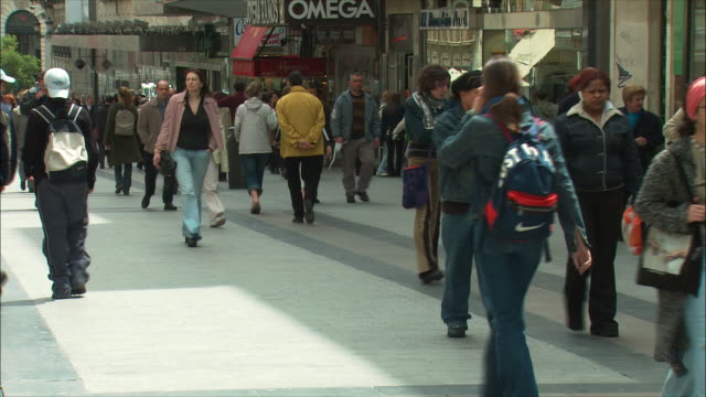 MS TU People walking in street, store exteriors and clock tower, Madrid, Spain