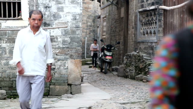 Fuzhou, China - May 29, 2017:  People walking in the alley in the old town in the morning