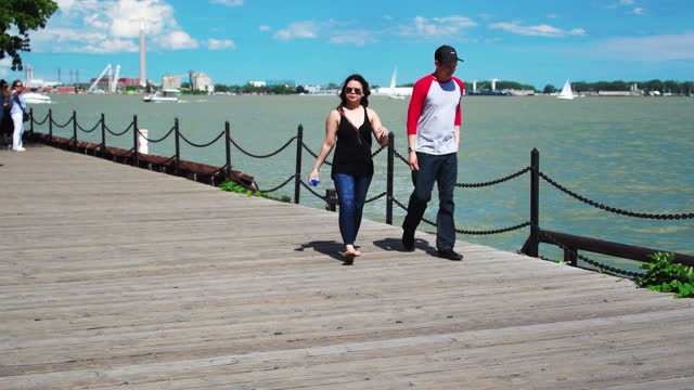 people walking in the boardwalk of the city's waterfront on june 24 in toronto, ontario, canada. lake ontario has an unusually high level of waters... - surface level stock videos & royalty-free footage