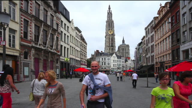 WS People walking in the old town of Antwerp in front of the Cathedral of Our Lady