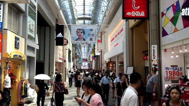 people walking in the shinsaibashi, osaka. - retail place stock videos & royalty-free footage