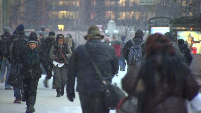 people walking in the snow on michigan avenue - michigan avenue chicago stock videos & royalty-free footage