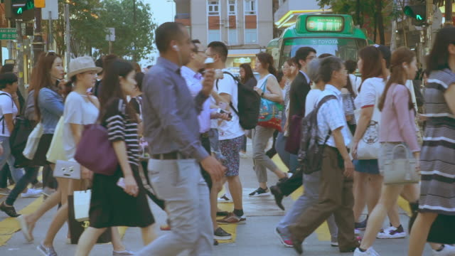 people walking in the street of hong kong city - crossroad stock videos & royalty-free footage