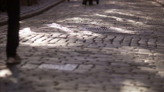 people walking in the street sweden. - cobblestone stock videos & royalty-free footage