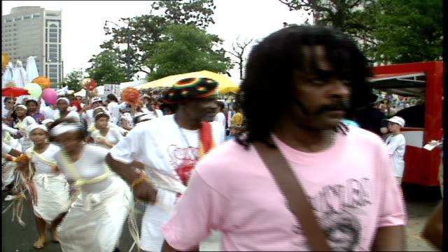 People Walking in the Sun Ra Parade Past Camera in Birmingham Alabama