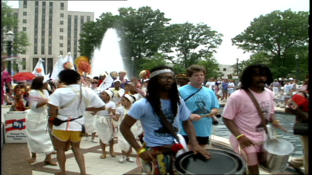 People Walking in the Sun Ra Parade Past Fountain in Birmingham Alabama
