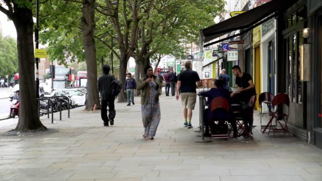 people walking in upper street in london islington - pavement stock videos & royalty-free footage
