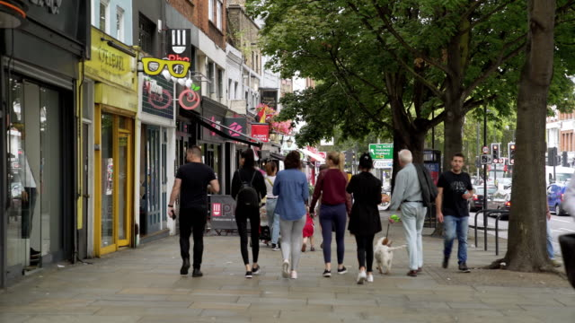 people walking in upper street in london islington - pavement stock videos & royalty-free footage