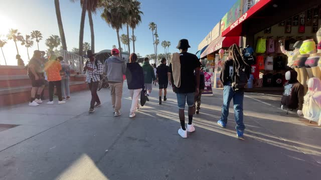 people walking in venice beach enjoying a sunny day time lapse - venice beach stock videos & royalty-free footage