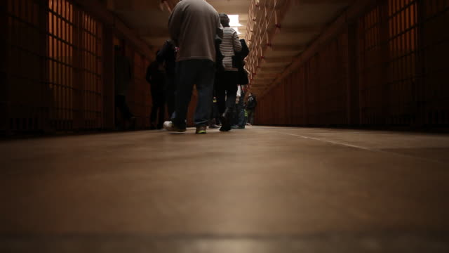 People walking inside of the Alcatraz prison in San Francisco.