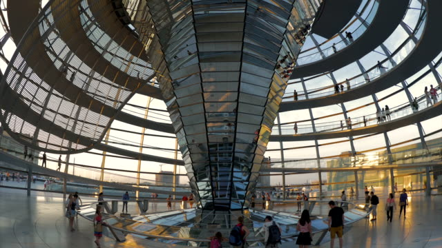 people walking inside reichstag at sunset,ws - cupola video stock e b–roll
