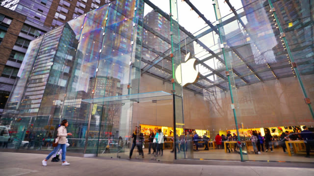 people walking into apple store. famous electronics shop on broadway upper west - walkable city stock videos & royalty-free footage