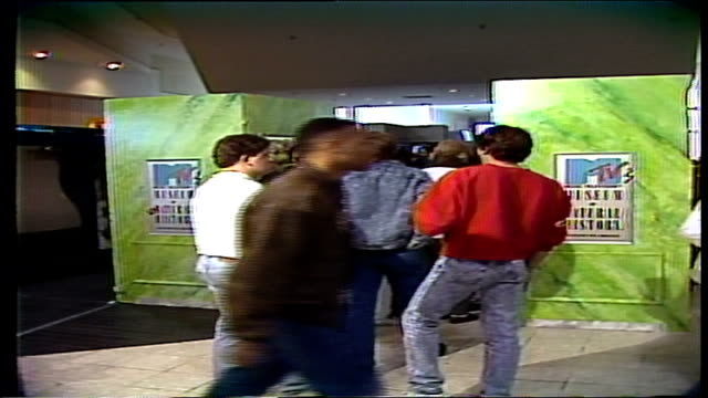 people walking into mtv unnatural history display and signs - mtv点の映像素材/bロール