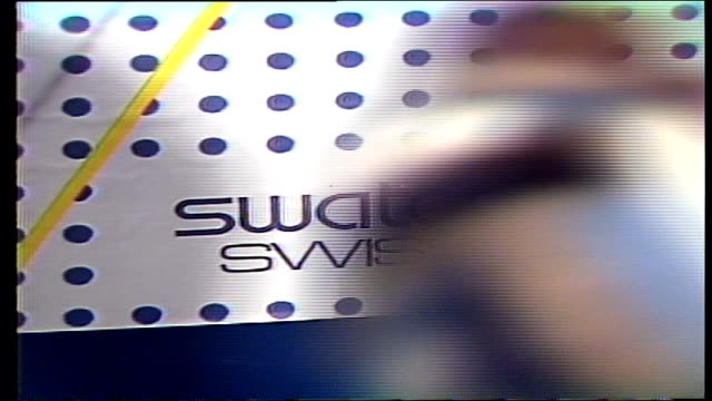people walking into swatch display - mtv1 stock-videos und b-roll-filmmaterial