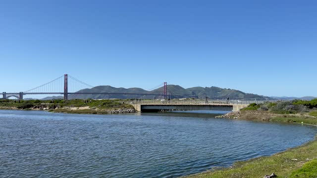 people walking, jogging, riding bicycles along the san francisco bay on a sunny day. - san francisco bay stock videos & royalty-free footage