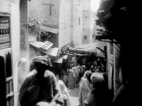 1934 b/w ms ha people walking narrow street / rabat, morocco - 1934 stock videos & royalty-free footage