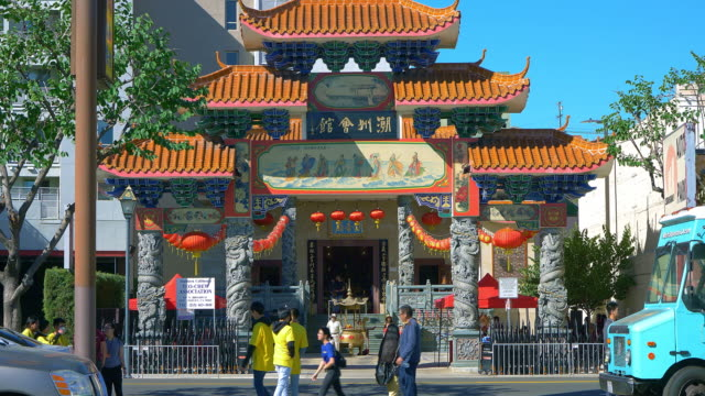 people walking near chinatown gateway pagoda gateway during chinese new year celebration in los angeles downtown, california, 4k - pagoda stock videos & royalty-free footage
