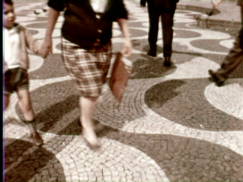 CU MS People walking near impressive building, Lisbon, Portugal / AUDIO