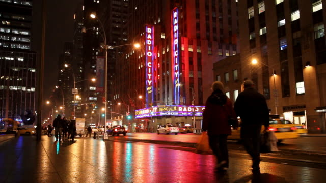 people walking near radio city music hall, new york, united states, - radio city music hall stock videos & royalty-free footage