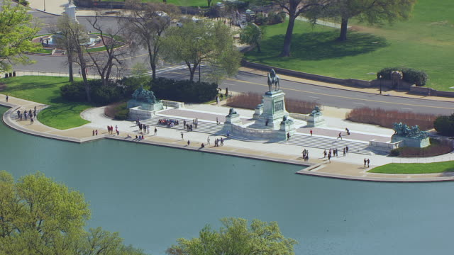 WS AERIAL POV People walking near Reflecting Pool at National Mall / Washington DC, United States