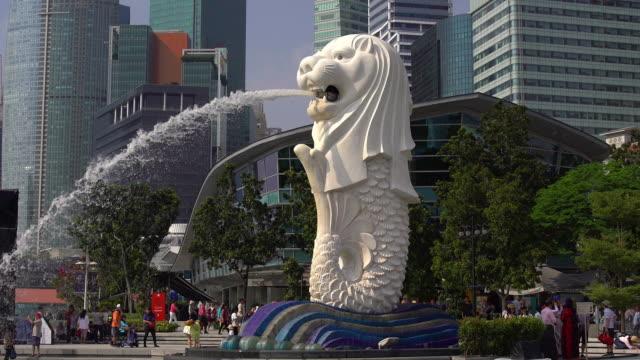 People walking near Singapore Lion statue