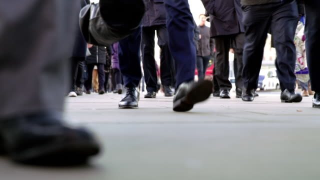 la people walking on a sidewalk in london - human leg stock videos & royalty-free footage