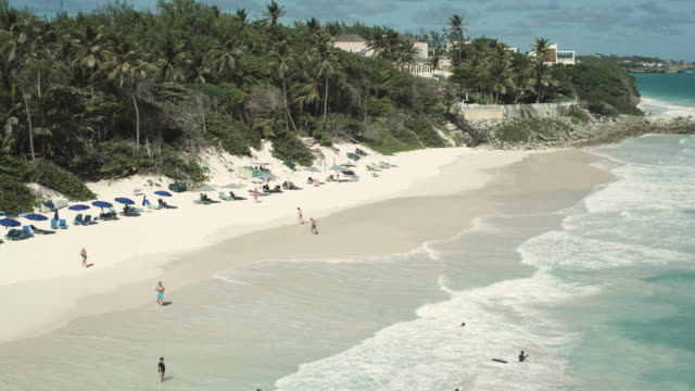WS HA PAN People walking on beach and swimming in sea, St. Michael's, Bridgetown, Barbados
