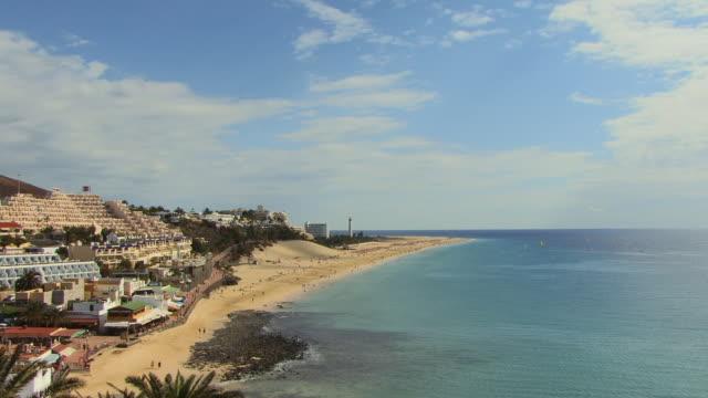 HA WS People walking on beach/ Morro Jable, Fuerteventura, Canary Islands