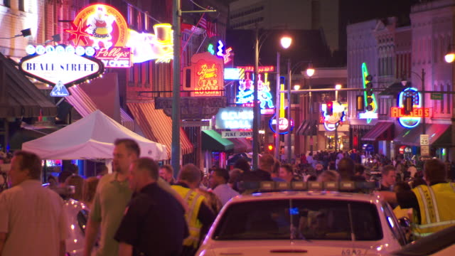 ws people walking on beale street at night / memphis, tennessee, united states - street party stock videos & royalty-free footage