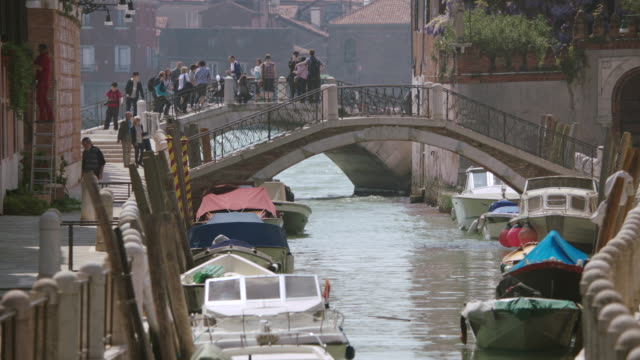 ws people walking on bridge over venice canal - arch bridge stock videos and b-roll footage