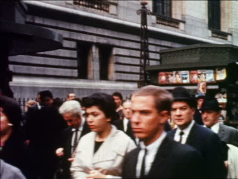 vídeos de stock, filmes e b-roll de 1960 people walking on busy city sidewalk / newsstand in background / nyc / newsreel - 1960