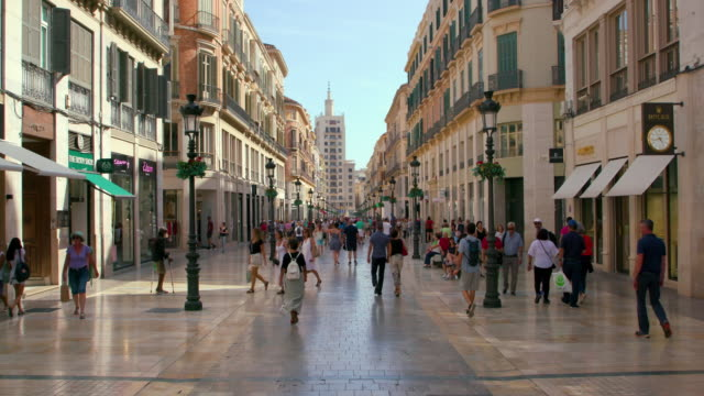 people walking on calle marques de larios, malaga, andalusia, spain - spanish culture stock videos & royalty-free footage