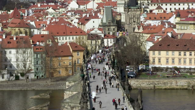 ms people walking on charles bridge between town / prague, hlavni mesto praha, czech republic - charles bridge stock videos and b-roll footage