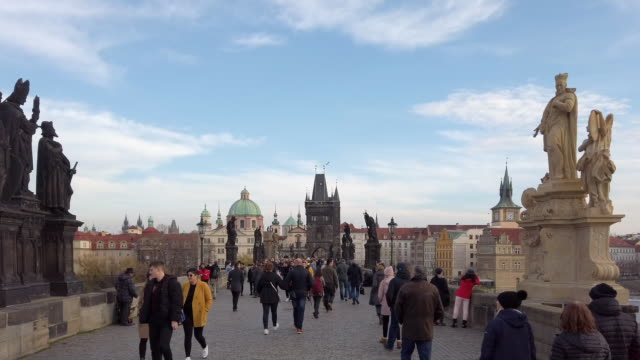 people walking on charles bridge in prague - charles bridge stock videos & royalty-free footage