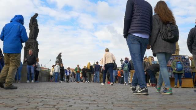 people walking on charles bridge in prague - charles bridge stock videos & royalty-free footage