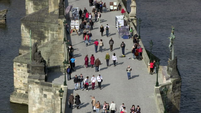 ms people walking on charles bridge over vltava river / prague, hlavni mesto praha, czech republic - river vltava stock videos & royalty-free footage