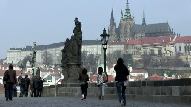 ms people walking on charles bridge / prague, hlavni mesto praha, czech republic - charles bridge stock videos & royalty-free footage