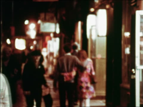 1969 blurred people walking on city street at night / greenwich village, nyc / industrial - greenwich village stock videos & royalty-free footage