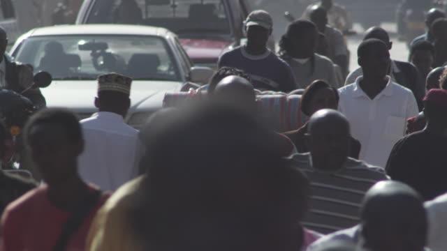 ws people walking on city street / kampala, kampala, uganda - kampala stock videos & royalty-free footage