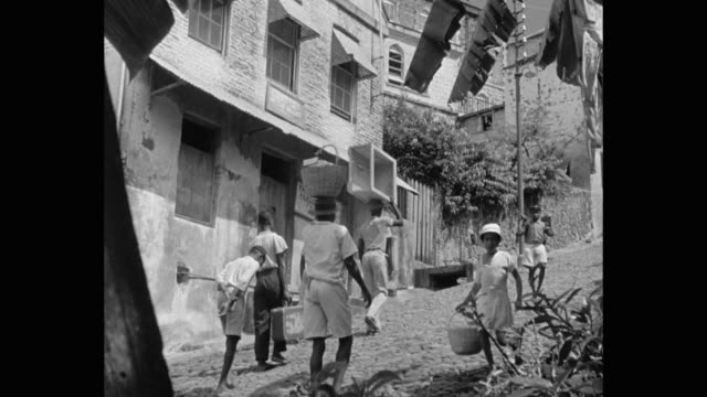 people walking on cobbled stone road, st george's, grenada - st. george's grenada stock videos and b-roll footage