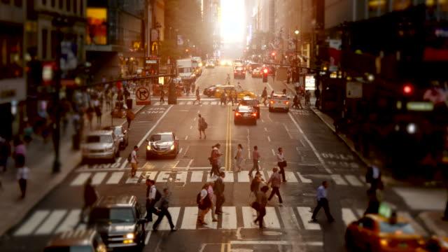 people walking on crowded city street. manhattan rush hour commuters scene. urban metropolis lifestyle - twilight stock videos & royalty-free footage