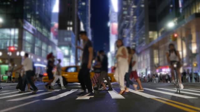 people walking on crowded city street. manhattan rush hour commuters scene. urban metropolis lifestyle