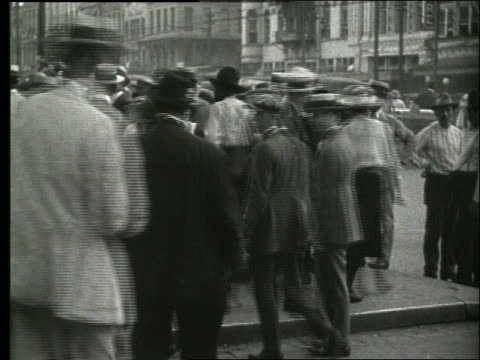 b/w people walking on crowded sidewalk / new orleans / 1915 / no sound - nun stock videos & royalty-free footage