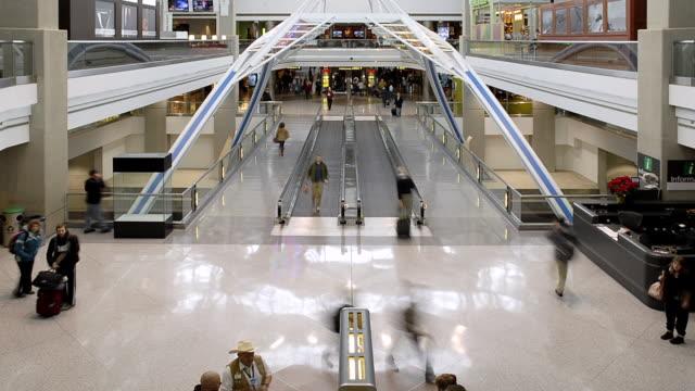 ms  t/l people walking on escalator international airport / denver, colorada, united states  - escalator stock videos & royalty-free footage