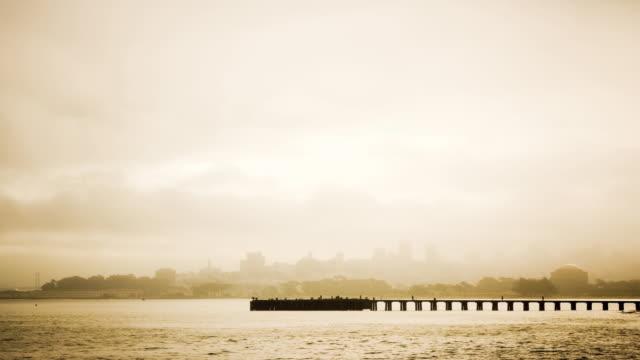 ws t/l people walking on fishing pier in foggy san francisco bay/ san francisco, california - okänt kön bildbanksvideor och videomaterial från bakom kulisserna