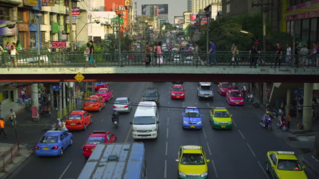 ha ws people walking on footbridge over busy downtown road, bangkok, ayuthaya, thailand - see other clips from this shoot 1448 stock videos and b-roll footage