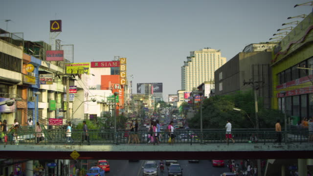 ws people walking on footbridge over busy downtown road, bangkok, ayuthaya, thailand - see other clips from this shoot 1448 stock videos and b-roll footage