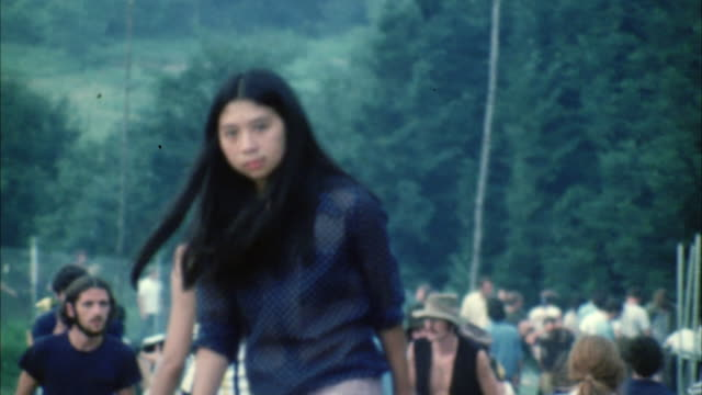 ms td cu people walking on grass at woodstock festival / bethel, new york, usa - anno 1969 video stock e b–roll