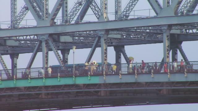 ms people walking on howrah bridge  / kolkata, west bengal, india - howrah bridge stock videos & royalty-free footage