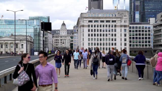 people walking on london bridge - bridge built structure stock videos & royalty-free footage